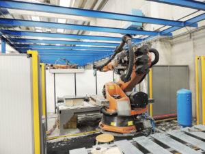 installazione robot in ambiente protetto ricavato con utilizzo di pareti mobili divisorie